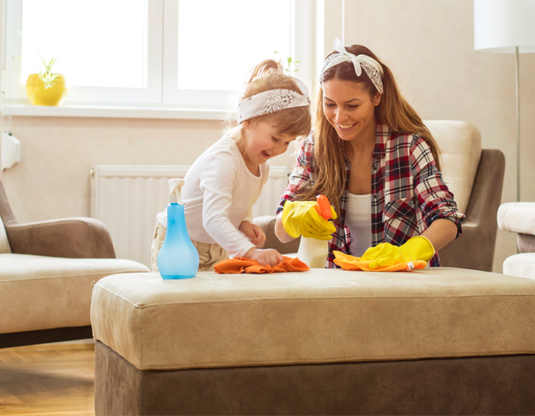 Woman and daughter cleaning house