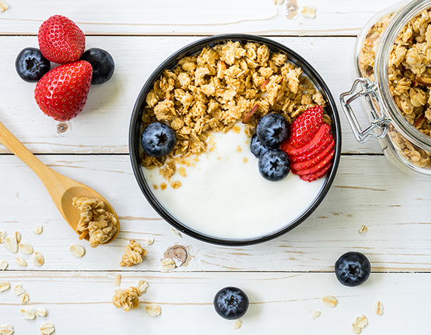 Bowl of yogurt and cereal on a counter - Probiotics